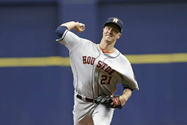 Houston Astros starting pitcher Zack Greinke throws during the first inning of Game 3 of a baseball American League Division Series against the Tampa Bay Rays, Monday, Oct. 7, 2019, in St. Petersburg, Fla. (AP Photo/Chris O'Meara)