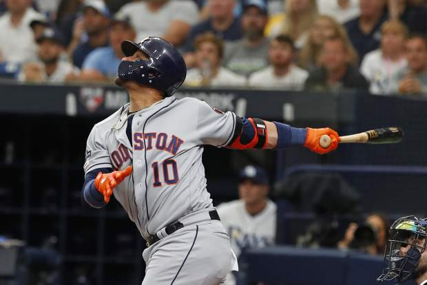 Houston Astros first baseman Yuli Gurriel (10) watches his ball during of Game 3 of a baseball American League Division Series against the Tampa Bay Rays, Monday, Oct. 7, 2019, in St. Petersburg, Fla. (AP Photo/Scott Audette)