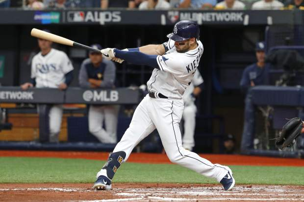 Tampa Bay Rays' Kevin Kiermaier hits a 3-run homer against the Houston Astros in the third inning of Game 3 of a baseball American League Division Series, Monday, Oct. 7, 2019, in St. Petersburg, Fla. (AP Photo/Scott Audette)