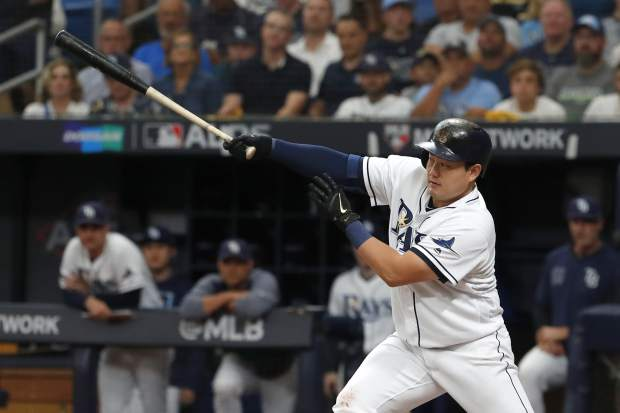 Tampa Bay Rays' Ji-Man Choi grounds out against the Houston Astros during the second inning of Game 3 of a baseball American League Division Series, Monday, Oct. 7, 2019, in St. Petersburg, Fla. (AP Photo/Scott Audette)