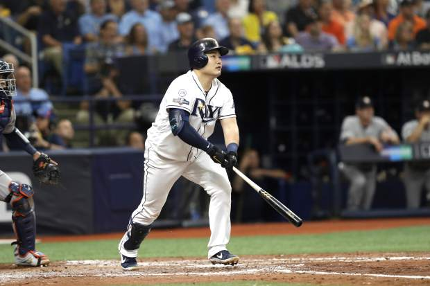 Tampa Bay Rays' Ji-Man Choi hits a home run against the Houston Astros during the third inning of Game 3 of a baseball American League Division Series, Monday, Oct. 7, 2019, in St. Petersburg, Fla. (AP Photo/Chris O'Meara)