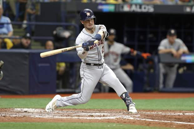 Houston Astros' Alex Bregman bats against the Tampa Bay Rays during Game 3 of a baseball American League Division Series, Monday, Oct. 7, 2019, in St. Petersburg, Fla. (AP Photo/Chris O'Meara)
