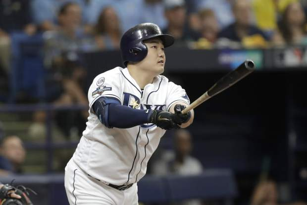 Tampa Bay Rays' Ji-Man Choi hits a home run against the Houston Astros during of Game 3 of a baseball American League Division Series, Monday, Oct. 7, 2019, in St. Petersburg, Fla. (AP Photo/Chris O'Meara)