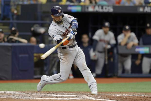 Houston Astros catcher Robinson Chirinos bats against the Tampa Bay Rays during Game 3 of a baseball American League Division Series, Monday, Oct. 7, 2019, in St. Petersburg, Fla. (AP Photo/Chris O'Meara)