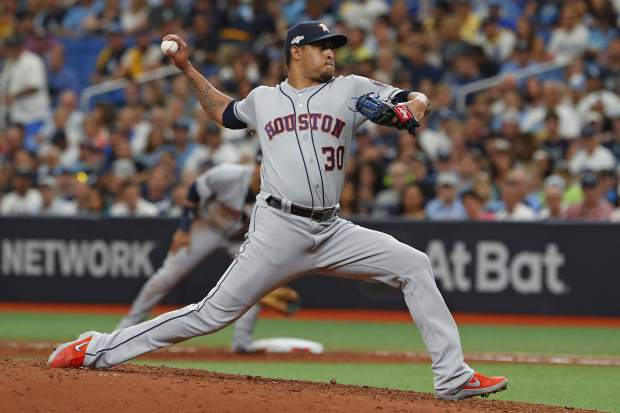 Houston Astros' Hector Rondon pitches against the Tampa Bay Rays during Game 3 of a baseball American League Division Series, Monday, Oct. 7, 2019, in St. Petersburg, Fla. (AP Photo/Scott Audette)