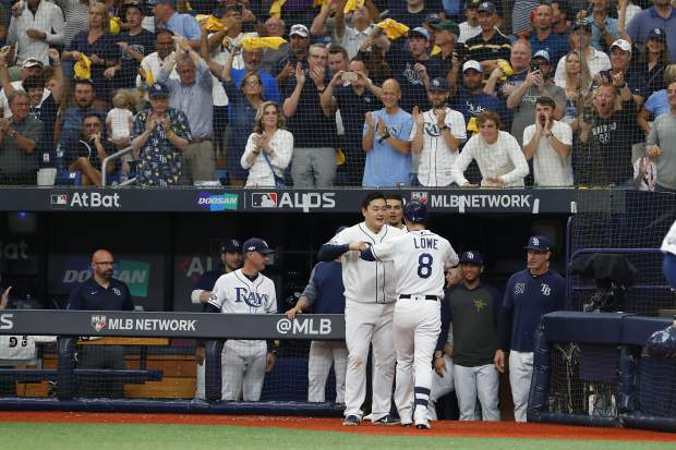 Tampa Bay Rays' Brandon Lowe (8) celebrates his solo home run against the Houston Astros during Game 3 of a baseball American League Division Series, Monday, Oct. 7, 2019, in St. Petersburg, Fla. (AP Photo/Scott Audette)