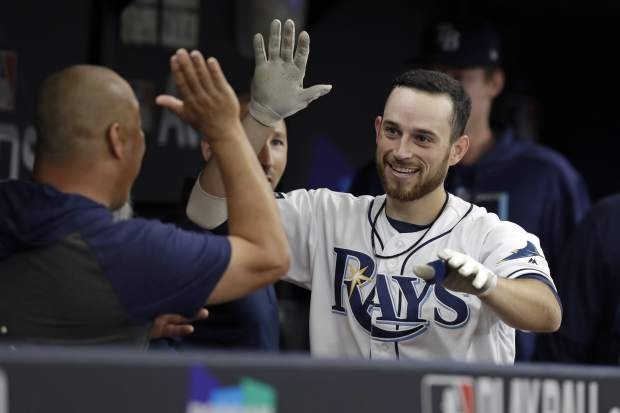 Tampa Bay Rays' Brandon Lowe, right, celebrates a solo home run against the Houston Astros in the fourth inning during Game 3 of a baseball American League Division Series, Monday, Oct. 7, 2019, in St. Petersburg, Fla. (AP Photo/Chris O'Meara)
