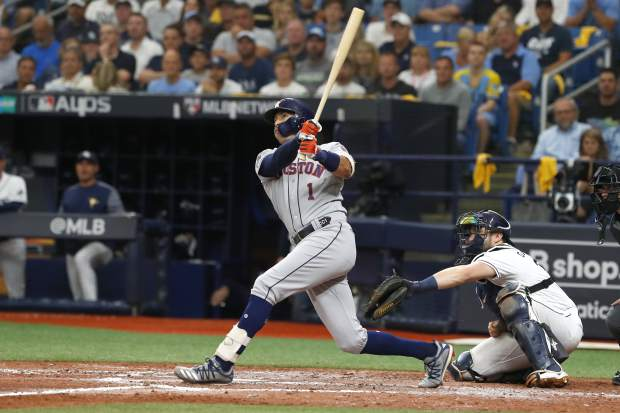 Houston Astros shortstop Carlos Correa (1) bats against the Tampa Bay Rays in the fourth inning during Game 3 of a baseball American League Division Series, Monday, Oct. 7, 2019, in St. Petersburg, Fla. (AP Photo/Scott Audette)
