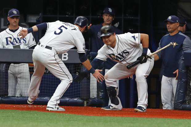Tampa Bay Rays first baseman Ji-Man Choi, right, congratulates Matt Duffy (5) after he scored a run against the Houston Astros during Game 3 of a baseball American League Division Series, Monday, Oct. 7, 2019, in St. Petersburg, Fla. (AP Photo/Scott Audette)