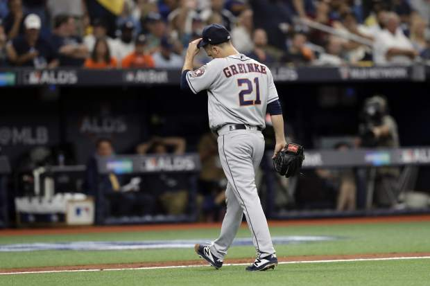 Houston Astros starting pitcher Zack Greinke (21) heads to the bench after he wa relived during Game 3 of a baseball American League Division Series against the Tampa Bay Rays, Monday, Oct. 7, 2019, in St. Petersburg, Fla. (AP Photo/Chris O'Meara)