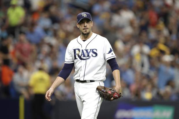 Tampa Bay Rays' Charlie Morton walks back to his bench after the fifth inning during Game 3 of a baseball American League Division Series against the Houston Astros, Monday, Oct. 7, 2019, in St. Petersburg, Fla. (AP Photo/Chris O'Meara)