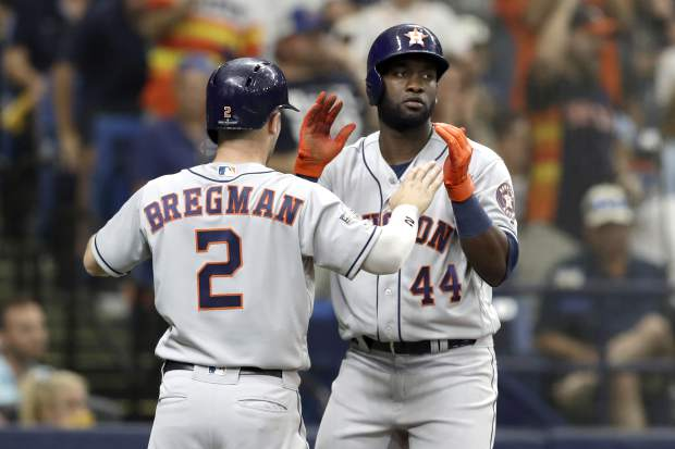 Houston Astros' Alex Bregman (2) and Yordan Alvarez (44) celebrate after scoring against the Tampa Bay Rays during Game 3 of a baseball American League Division Series, Monday, Oct. 7, 2019, in St. Petersburg, Fla. (AP Photo/Chris O'Meara)