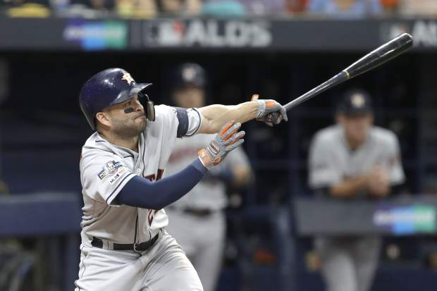 Houston Astros' Jose Altuve bats against the Tampa Bay Rays during Game 3 of a baseball American League Division Series, Monday, Oct. 7, 2019, in St. Petersburg, Fla. (AP Photo/Chris O'Meara)