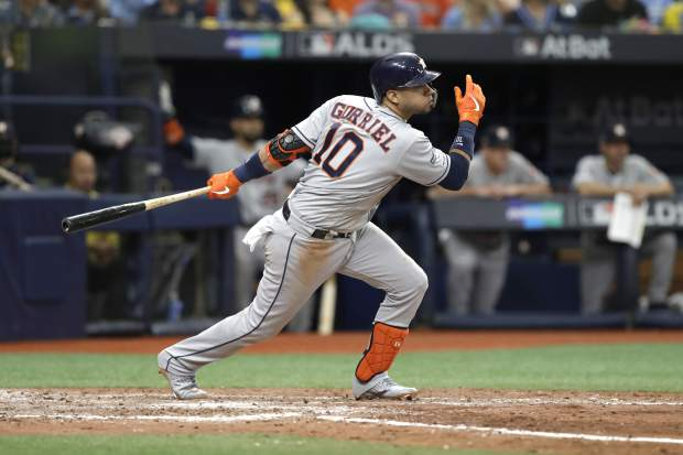Houston Astros' Yuli Gurriel bats against the Tampa Bay Rays during Game 3 of a baseball American League Division Series, Monday, Oct. 7, 2019, in St. Petersburg, Fla. (AP Photo/Chris O'Meara)