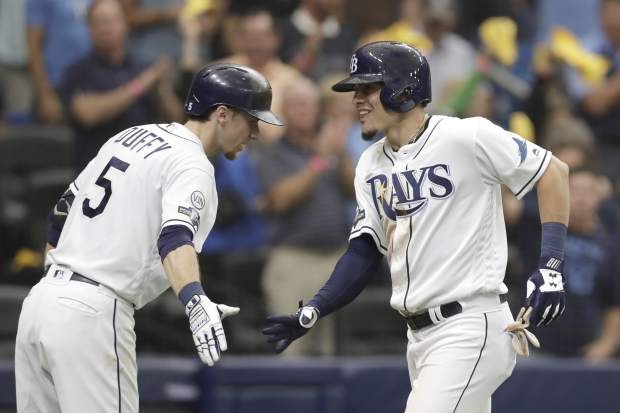 Tampa Bay Rays' Willy Adames, right, celebrates his sixth inning home run against the Houston Astros with Matt Duffy (5) during Game 3 of a baseball American League Division Series, Monday, Oct. 7, 2019, in St. Petersburg, Fla. (AP Photo/Chris O'Meara)