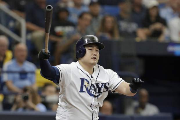 Tampa Bay Rays' Ji-Man Choi bats against the Houston Astros during Game 3 of a baseball American League Division Series, Monday, Oct. 7, 2019, in St. Petersburg, Fla. (AP Photo/Chris O'Meara)