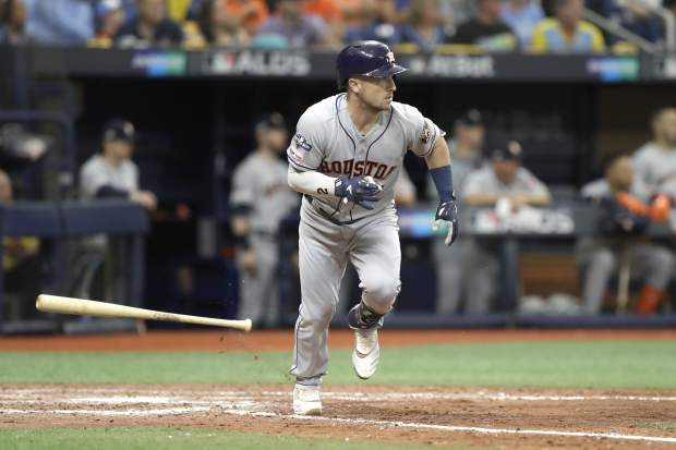 Houston Astros' Alex Bregman runs to first after batting against the Tampa Bay Rays during Game 3 of a baseball American League Division Series, Monday, Oct. 7, 2019, in St. Petersburg, Fla. (AP Photo/Chris O'Meara)