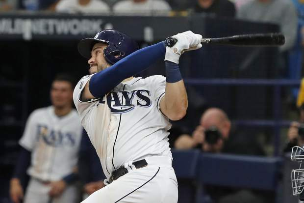 Tampa Bay Rays' Travis d'Arnaud (37) bats against the Houston Astros during Game 3 of a baseball American League Division Series, Monday, Oct. 7, 2019, in St. Petersburg, Fla. (AP Photo/Scott Audette)