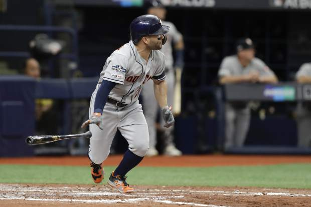 Houston Astros' Jose Altuve hits a double against the Tampa Bay Rays during the third inning of Game 3 of a baseball American League Division Series, Monday, Oct. 7, 2019, in St. Petersburg, Fla. (AP Photo/Chris O'Meara)
