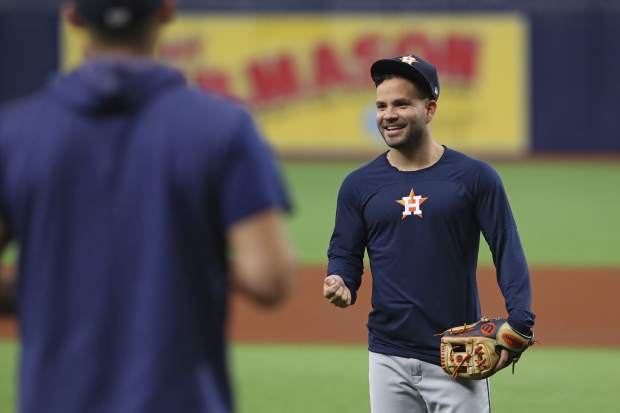 Houston Astros second baseman Jose Altuve, right, shares a laugh with teammates while warm up before Game 3 of a baseball American League Division Series against the Tampa Bay Rays, Monday, Oct. 7, 2019, in St. Petersburg, Fla. (AP Photo/Scott Audette)