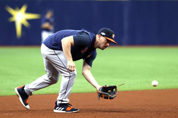 Houston Astros third baseman Alex Bregman warms up before Game 3 of a baseball American League Division Series against the Tampa Bay Rays, Monday, Oct. 7, 2019, in St. Petersburg, Fla. (AP Photo/Scott Audette)