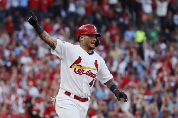 St. Louis Cardinals' Yadier Molina reacts after hitting an RBI-single during the eighth inning in Game 4 of a baseball National League Division Series against the Atlanta Braves, Monday, Oct. 7, 2019, in St. Louis. (AP Photo/Jeff Roberson)