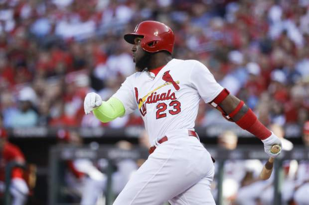 St. Louis Cardinals' Marcell Ozuna watches his solo home run during the fourth inning in Game 4 of a baseball National League Division Series against the Atlanta Braves, Monday, Oct. 7, 2019, in St. Louis. (AP Photo, Charlie Riedel)