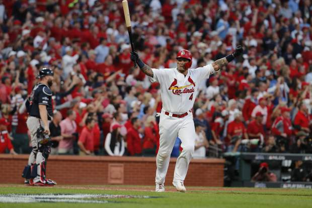 St. Louis Cardinals' Yadier Molina celebrates after hitting a sacrifice fly to score Kolten Wong and defeat the Atlanta Braves in Game 4 of a baseball National League Division Series, Monday, Oct. 7, 2019, in St. Louis. The Cardinals won 5-4.  (AP Photo/Jeff Roberson)