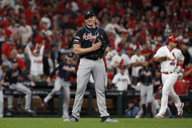 Atlanta Braves relief pitcher Mark Melancon celebrates the team's 3-1 victory over the St. Louis Cardinals in Game 3 of a baseball National League Division Series on Sunday, Oct. 6, 2019, in St. Louis. (AP Photo/Jeff Roberson)s