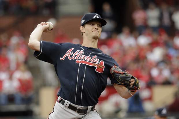 Atlanta Braves starting pitcher Mike Soroka throws a pitch during the first inning in Game 3 of a National League Division Series baseball game against the St. Louis Cardinals, Sunday, Oct. 6, 2019, in St. Louis. (AP Photo/Charlie Riedel)