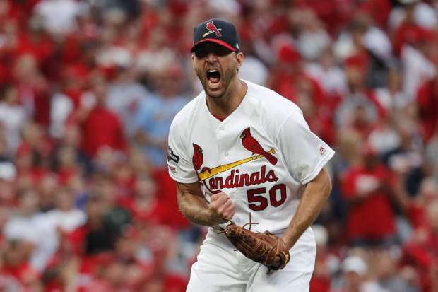 St. Louis Cardinals starting pitcher Adam Wainwright celebrates after striking out Atlanta Braves' Freddie Freeman to end the top of the sixth inning in Game 3 of a baseball National League Division Series on Sunday, Oct. 6, 2019, in St. Louis. (AP Photo/Jeff Roberson)