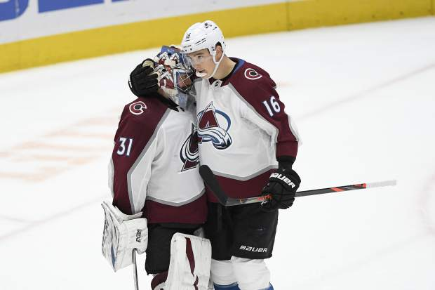 Colorado Avalanche defenseman Nikita Zadorov (16), of Russia, celebrates with goaltender Philipp Grubauer (31), of Germany, after an NHL hockey game against the Washington Capitals, Monday, Oct. 14, 2019, in Washington. (AP Photo/Nick Wass)