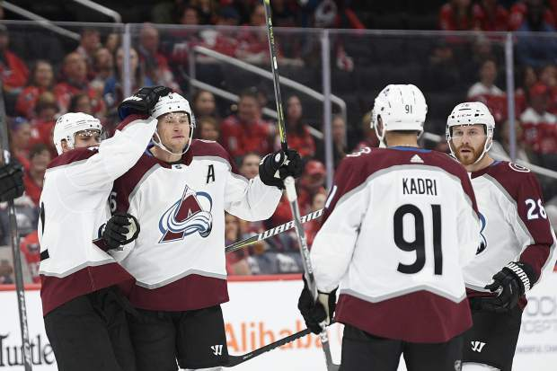 Colorado Avalanche defenseman Erik Johnson, second from left, celebrates his goal with center Nazem Kadri (91), right wing Joonas Donskoi, left, and defenseman Ian Cole (28) and during the first period of an NHL hockey game against the Washington Capitals, Monday, Oct. 14, 2019, in Washington. (AP Photo/Nick Wass)