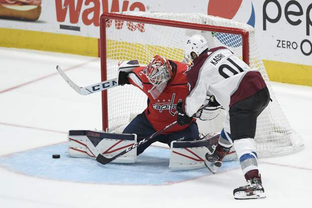 Colorado Avalanche center Nazem Kadri (91) tries to get the puck past Washington Capitals goaltender Ilya Samsonov (30), of Russia, during the third period of an NHL hockey game, Monday, Oct. 14, 2019, in Washington. (AP Photo/Nick Wass)