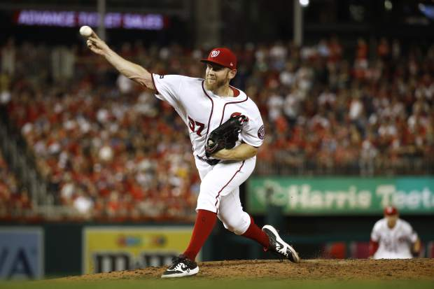 Washington Nationals relief pitcher Stephen Strasburg throws to the Milwaukee Brewers in the sixth inning of a National League wild card baseball game, Tuesday, Oct. 1, 2019, in Washington. (AP Photo/Patrick Semansky)