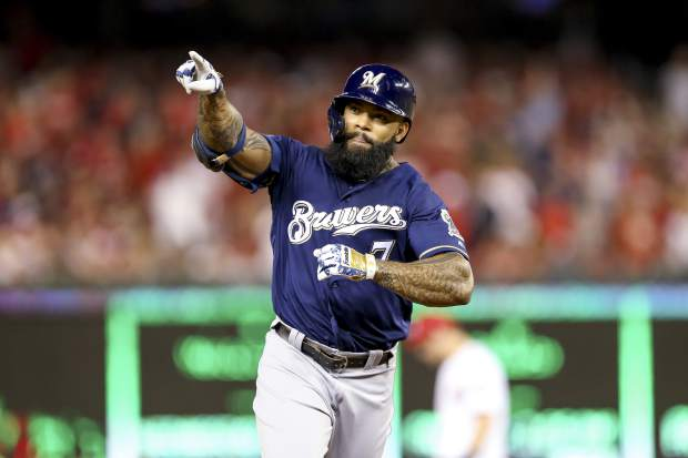 Milwaukee Brewers' Eric Thames gestures after hitting a solo home run during the second inning of a National League wild card baseball game against the Washington Nationals at Nationals Park, Tuesday, Oct. 1, 2019, in Washington. (AP Photo/Andrew Harnik)