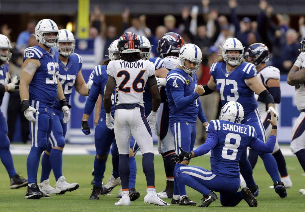 Indianapolis Colts kicker Adam Vinatieri (4) reacts with punter Rigoberto Sanchez (8) after kicking the winning field goal during the second half of an NFL football game against the Denver Broncos, Sunday, Oct. 27, 2019, in Indianapolis. (AP Photo/Darron Cummings)