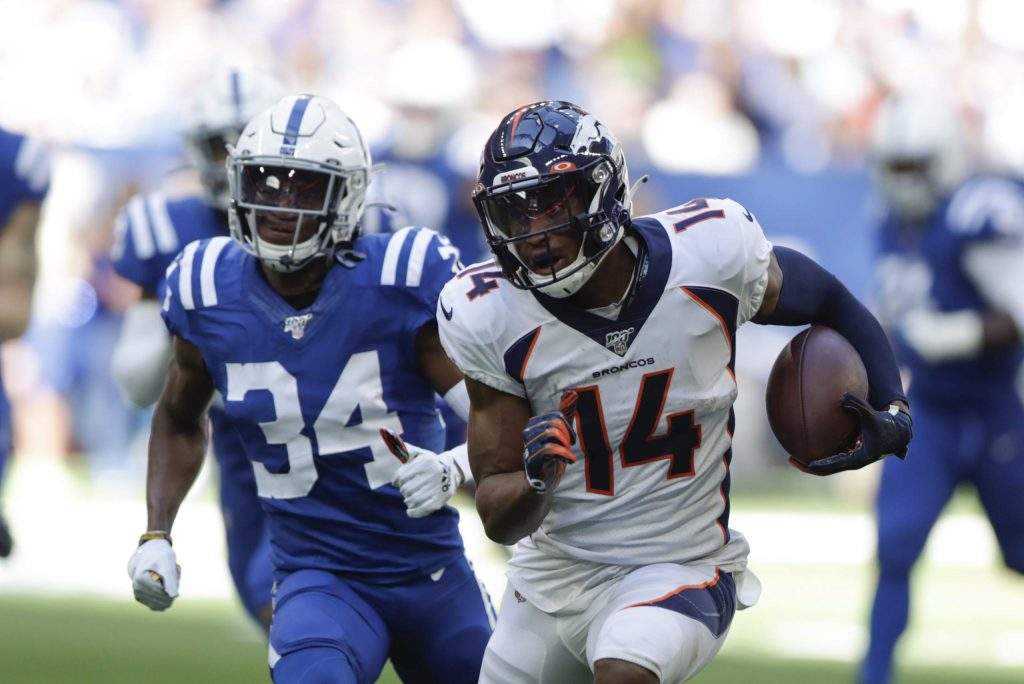 Denver Broncos wide receiver Courtland Sutton (14) is chased by Indianapolis Colts' Rock Ya-Sin (34) during the first half of an NFL football game, Sunday, Oct. 27, 2019, in Indianapolis. (AP Photo/Michael Conroy)