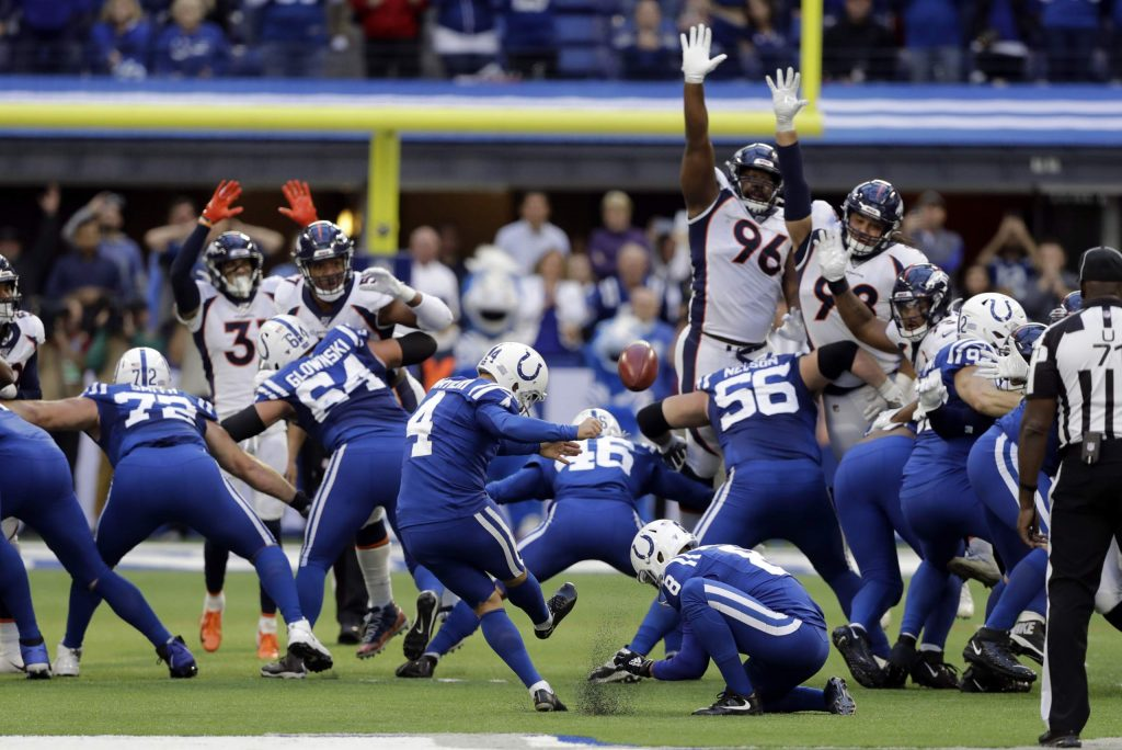 Indianapolis Colts kicker Adam Vinatieri (4) boots the winning field goal out of the hold of Rigoberto Sanchez (8) during the second half of an NFL football game against the Denver Broncos, Sunday, Oct. 27, 2019, in Indianapolis. (AP Photo/Darron Cummings)