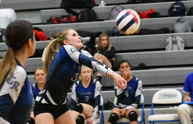 Coal Ridge TItan Brecken Guccini sets the ball during Tuesday night's game against the Aspen Skiers at Coal Ridge High School.