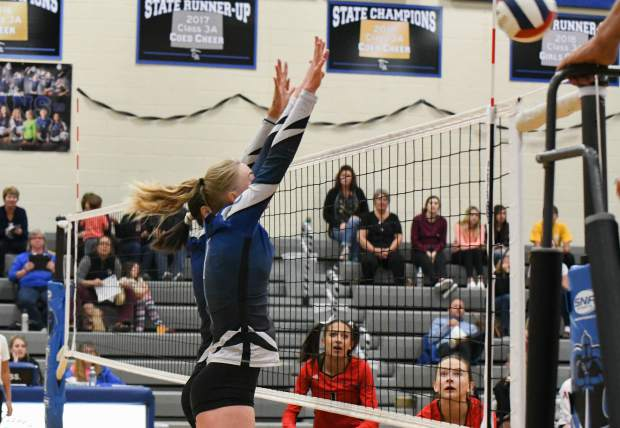 Two Coal Ridge Titans jump to block the ball at the net during Tuesday night's home game against the Aspen Skiers.
