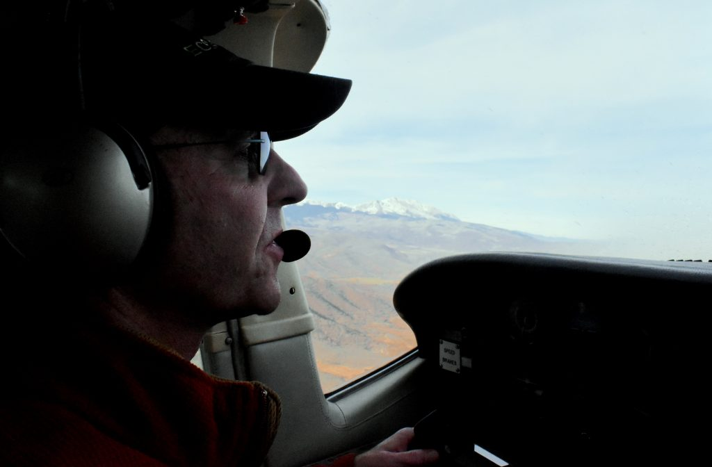 Pilot Gary Kraft talks about the importance of watersheds during an EcoFlight trip.