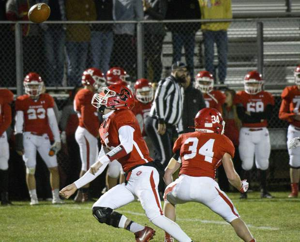Glenwood's Evan Heyl can only watch as the snap sails over his head during the second qaurter aganinst Palisade Friday. Heyl was able to recover the loose ball, but was sacked for a big loss on the play.