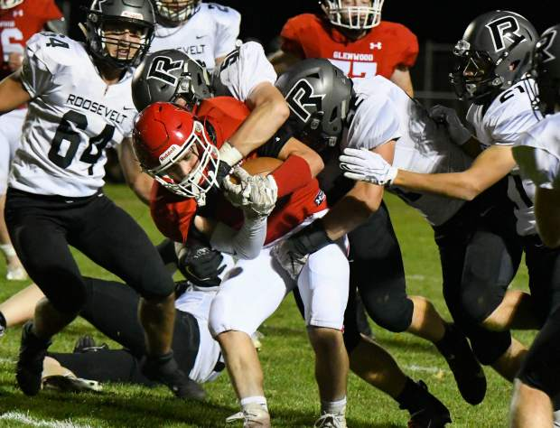 Glenwood Springs Demon Dylan Albright is stopped short of the first down during Friday night's game against the Roosevelt Rough Riders.