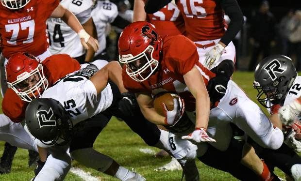 A Glenwood Springs Demon is tripped up by the defending Roosevelt Rough Riders during Friday night's game in Carbondale.