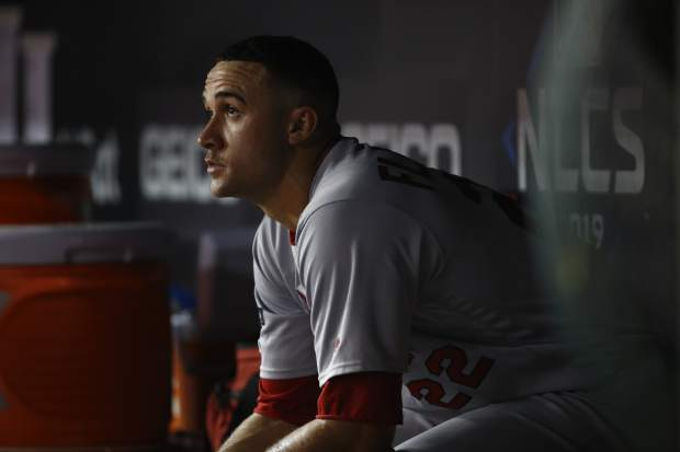 St. Louis Cardinals starting pitcher Jack Flaherty sits in the dugout after the Washington Nationals scored four runs during the third inning of Game 3 of the baseball National League Championship Series Monday, Oct. 14, 2019, in Washington. (AP Photo/Patrick Semansky)