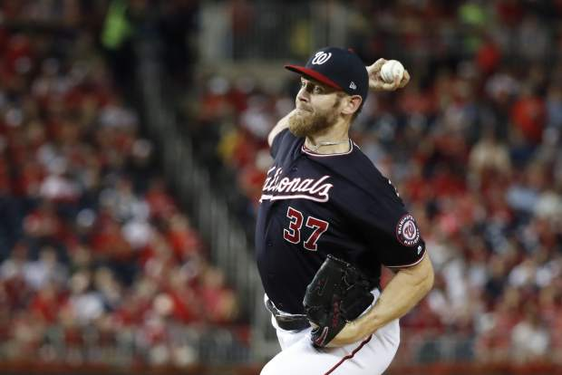 Washington Nationals starting pitcher Stephen Strasburg throws during the first inning of Game 3 of the baseball National League Championship Series against the St. Louis Cardinals Monday, Oct. 14, 2019, in Washington. (AP Photo/Jeff Roberson)