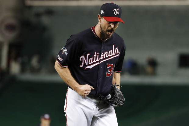 Washington Nationals starting pitcher Max Scherzer (31) reacts after striking out Los Angeles Dodgers left fielder Chris Taylor (3) in the seventh inning in Game 4 of a baseball National League Division Series, Monday, Oct. 7, 2019, in Washington. (AP Photo/Alex Brandon)