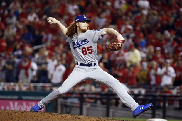 Los Angeles Dodgers pitcher Dustin May (85) throws against the Washington Nationals during the seventh inning in Game 4 of a baseball National League Division Series, Monday, Oct. 7, 2019, in Washington. (AP Photo/Patrick Semansky)