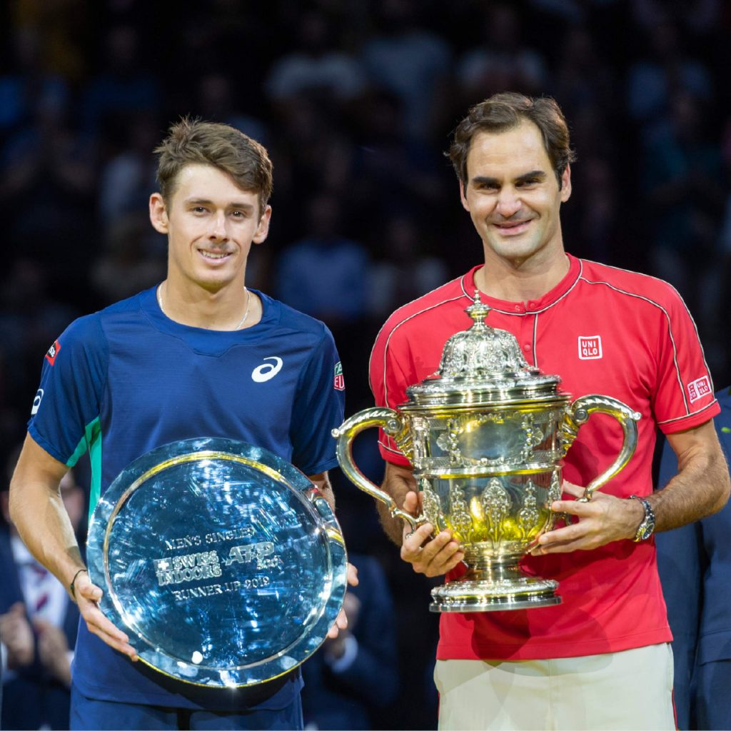 Switzerland's Roger Federer, right, and Australia's Alex De Minaur, left, pose after the final at the Swiss Indoors tennis tournament at the St. Jakobshalle in Basel, Switzerland, on Sunday Oct. 27, 2019. (Georgios Kefalas/Keystone via AP)